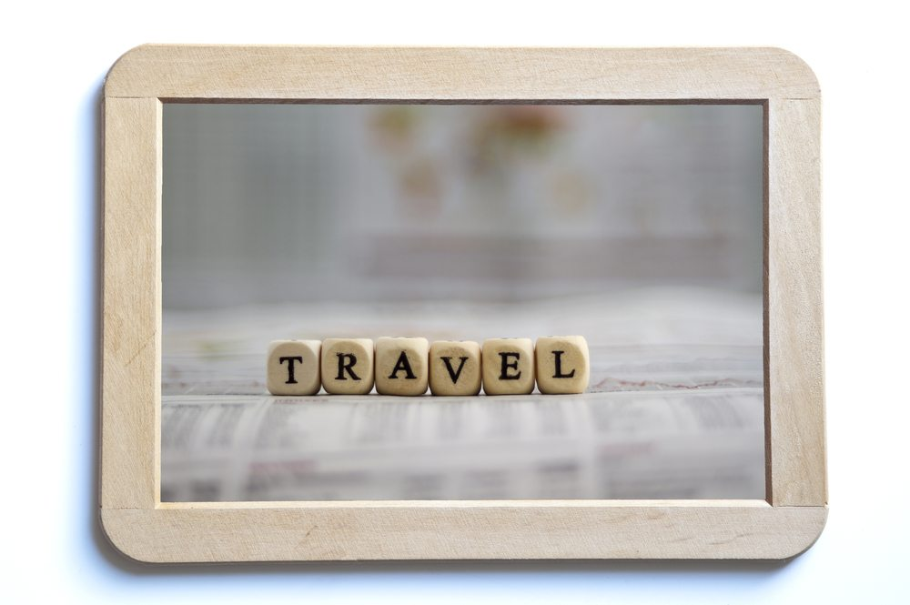 framed image of blocks spelling travel