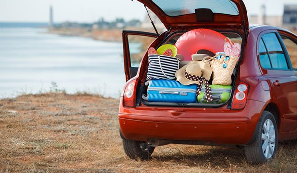 A Car Loaded Ready For A Holiday, Parked Overlooking Beach