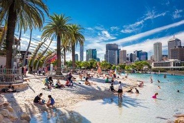 Southbank Beach with people playing on a hot sunny day
