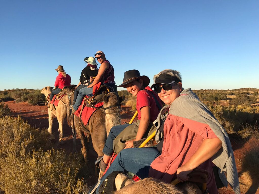 family riding camels