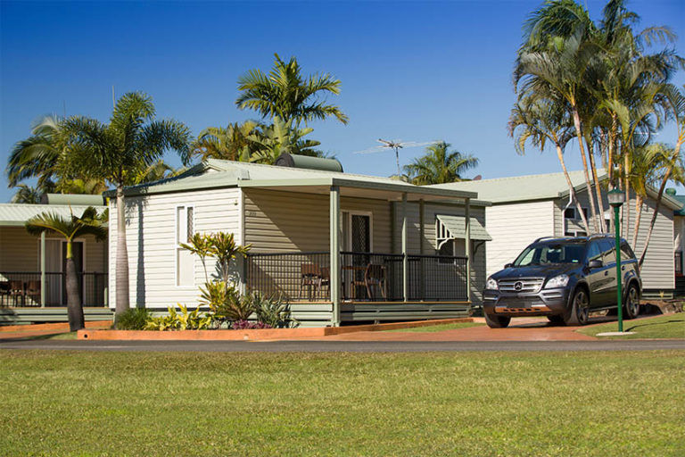 Front view of an Alfresco Cabin with a 4 wheel drive in front of it