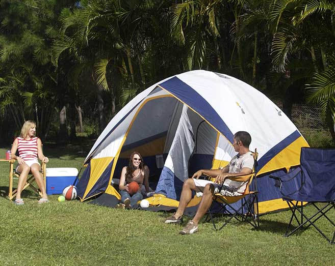 Family camping on an unpowered campsite at Brisbane Holiday Village