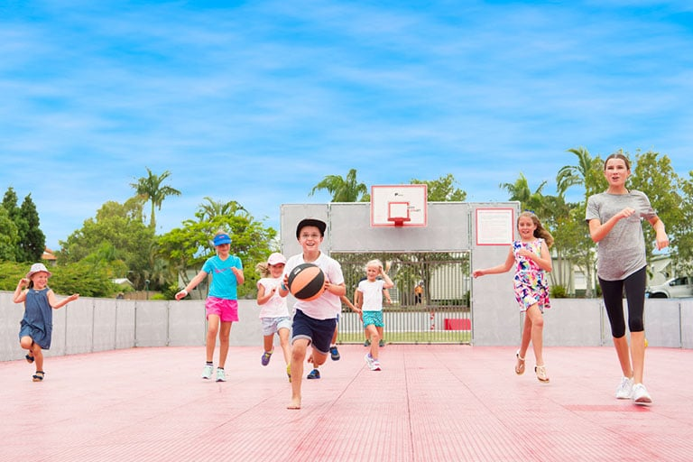 Kids playing basketball on the multipurpose sports field at Brisbane Holiday Village
