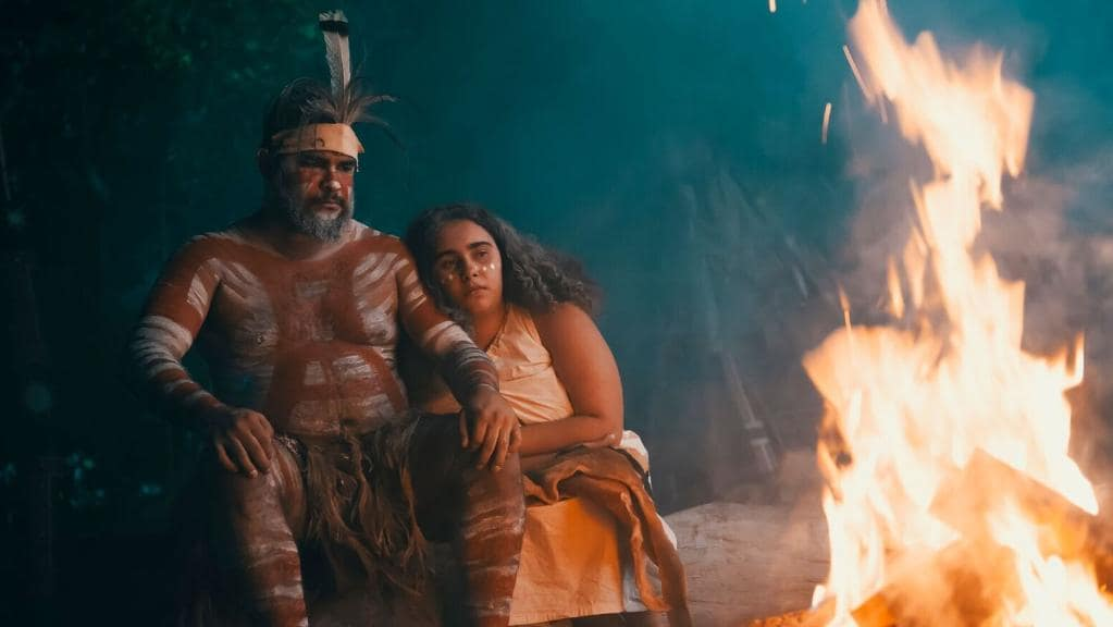 Two Indigenous Australians around a campfire. Reenacting cultural stories and traditions for Spirits of the Red Sands