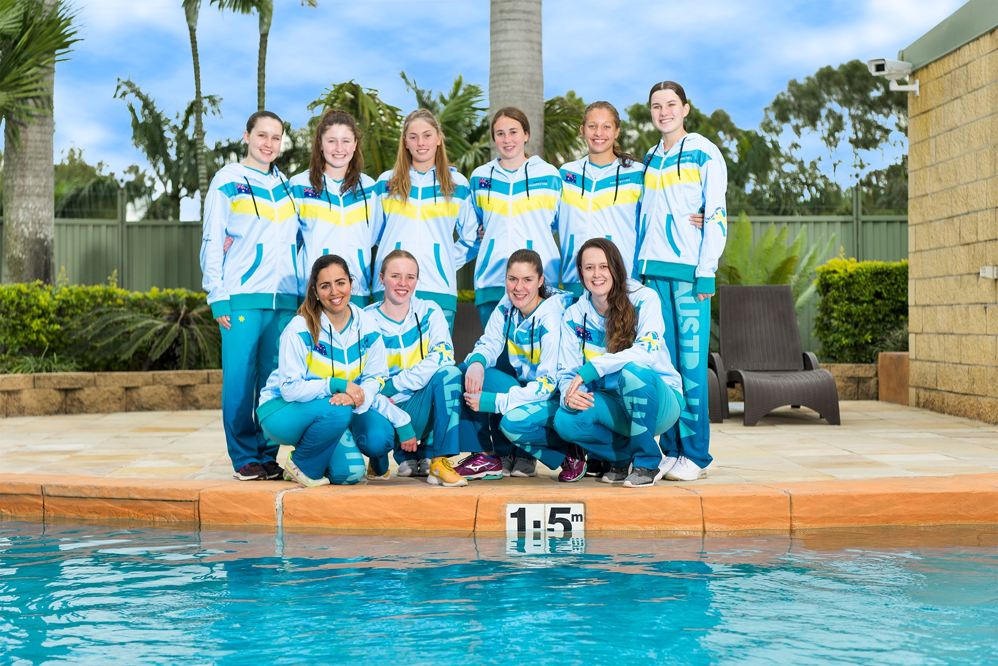 Sports Team posing by the Lagoon Pool at Brisbane Holiday Village