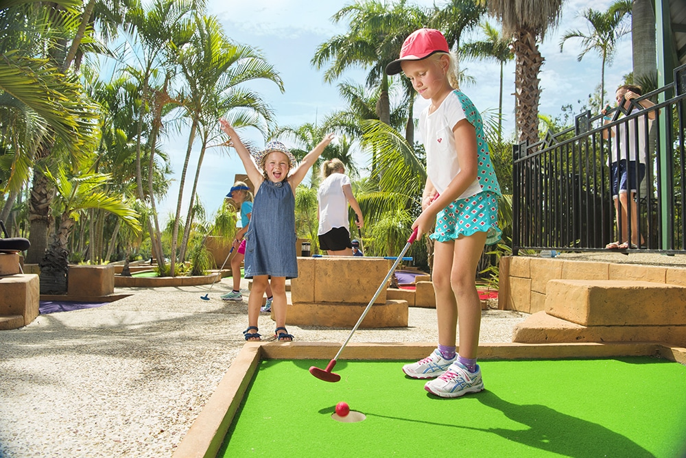 Two girls playing mini golf on the 18 hole mini golf course at Brisbane Holiday Village