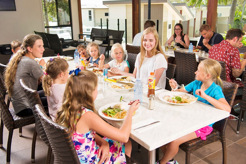 Teenagers and kids enjoying lunch at Lagoona Resort Restaurant