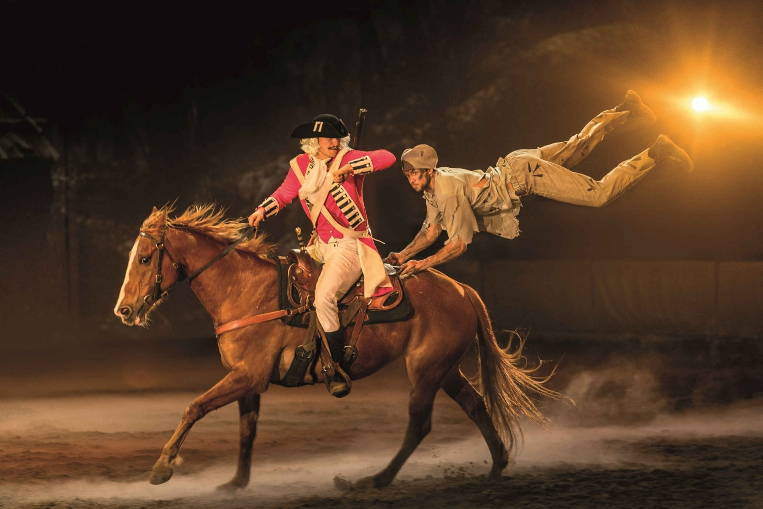 Australian Outback Spectacular performers jumping onto a running horse
