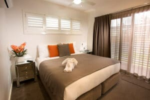 Main bedroom of the luxury Penthouse Cabin Apartment at Brisbane Holiday Village