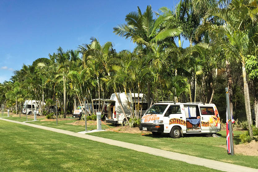 Powered tent and camping site with campervans at Brisbane Holiday Village